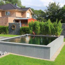 steinmauer-pool-draussen-stein